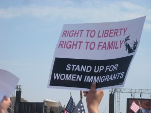 "Hand holding ""Right to liberty Right to Family"" banner"